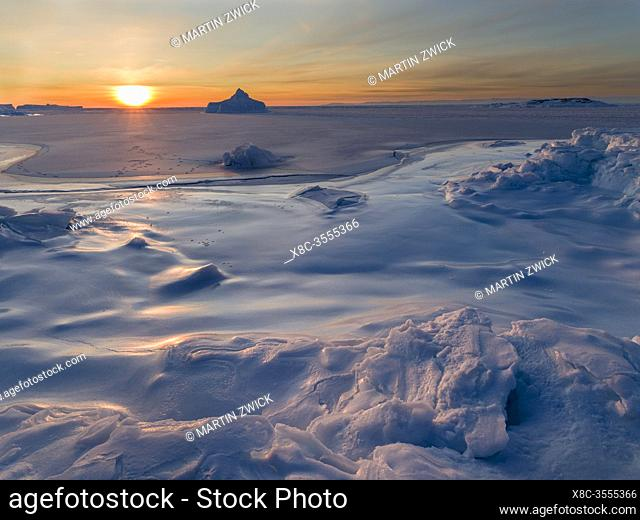 Sunset at the shore of frozen Disko Bay. Disko Bay during winter, West Greenland. America, North America, Greenland, Denm