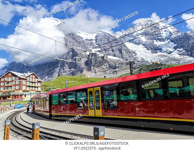 A train approaching the Kleine-Scheidegg station, under the awesome northwall of the Eiger and Mönch , Bernese Alps, Switzerland Europe