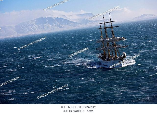 Traditional boat sailing on ocean, German Navy sail boat Gorch Fock in waters close to Reykjavik, Iceland