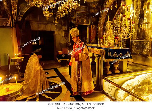 An Armenian orthodox mass at the in the Altar of the Crucifixion in the Church of the Holy Sepulchre site of the last five stations of the Cross and venerated...