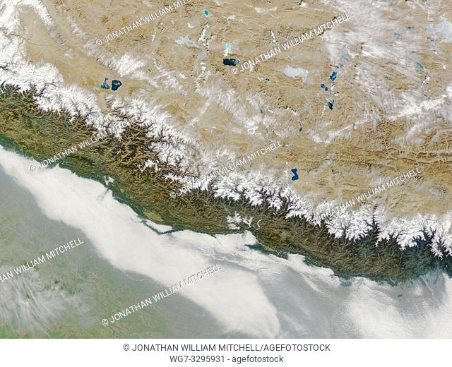 EARTH Nepal -- 09 Jan 2004 -- The snow-capped peaks of the Himalaya cut across the center of this NASA MODIS satellite image