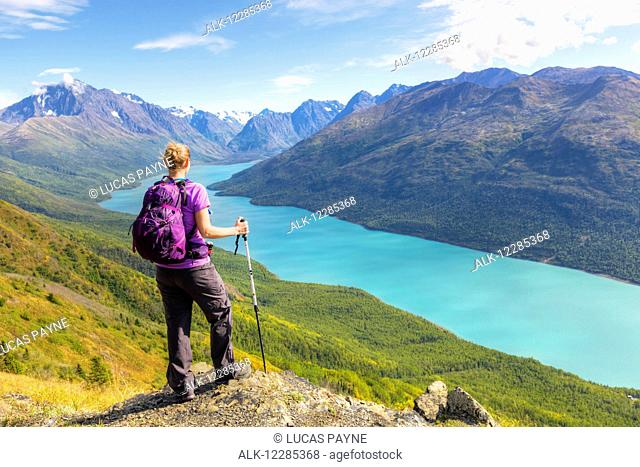 Female hiker overlooking Eklutna Lake from Twin Peaks Trail, Chugach State Park, Southcentral Alaska, summer