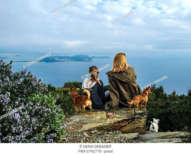 France,Var,Mother and daughter view from the back looking at the mediterranean sea/