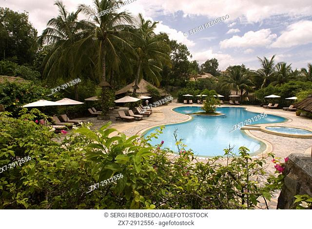 Swimming pool in amazing tropical luxury hotel. Mui Ne, Vietnam travel destinations, Vietnam