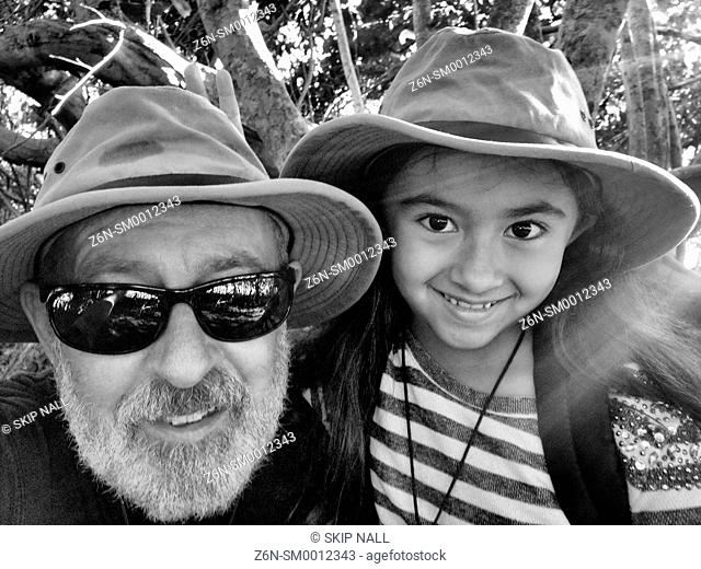 A father and his daughter self portrait while on a hike