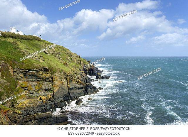Early summer afternoon sunshine after a storm at the Lizard Lighthouse on the cliffs at Lizard Point in the Lizard Peninsula, Cornwall, UK