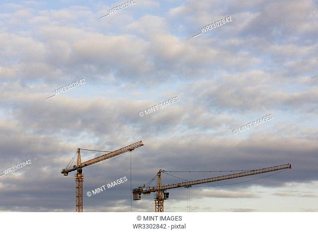 Tower Cranes and Clouds