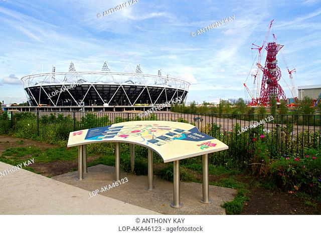 England, London, Stratford. The London 2012 Olympic stadium, the ArcelorMittal Orbit observation tower and site map in the Olympic Park in Stratford in the east...