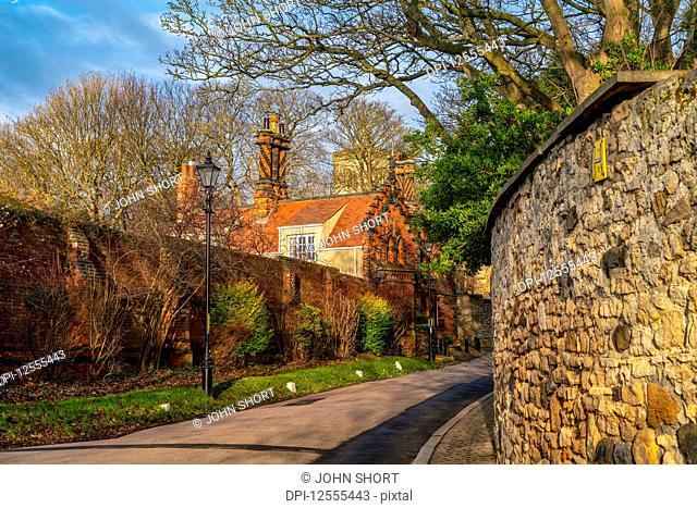 Stone walls and homes along a path; Whitburn Village, Tyne and Wear, England