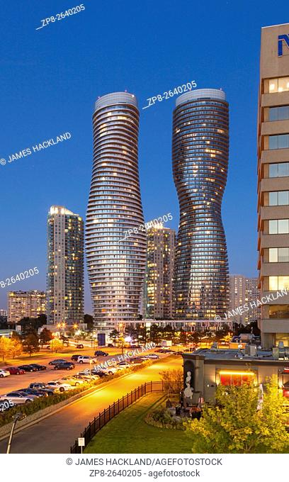 Absolute World Towers 4 & 5 (The Marilyn Monroe Towers) at night. Mississauga, Peel Region, Ontario, Canada