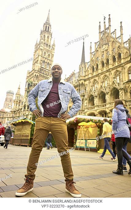 man standing in front of Neues Rathaus at Marienplatz in Munich, Germany