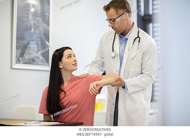 Doctor examiming patient in medical practice