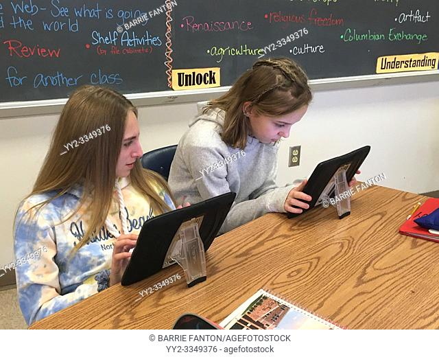 7th Grade Girls Using iPads in Social Studies Class, Wellsville, New York, USA