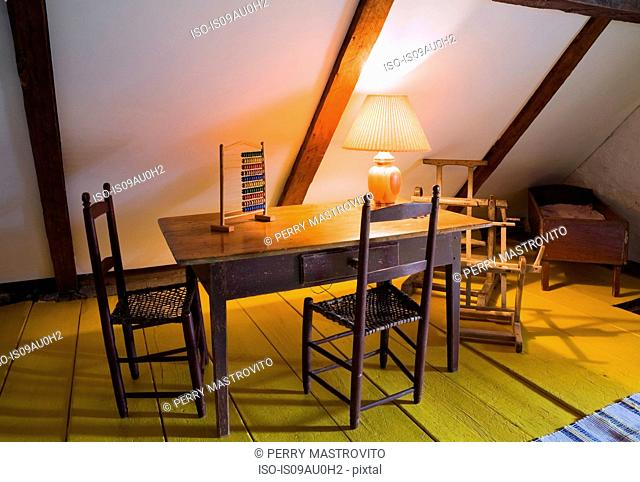 Table and chairs in room with wood beamed vaulted ceiling