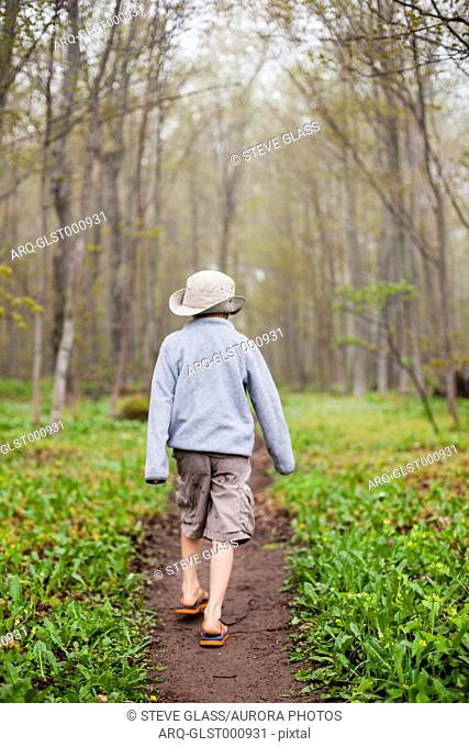 A 6 year old Japanese American boy walks along a trail above the Pictured Rocks National Lakeshore, Lake Superior