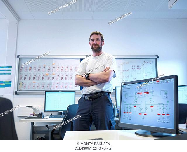 Portrait of offshore windfarm engineer in office