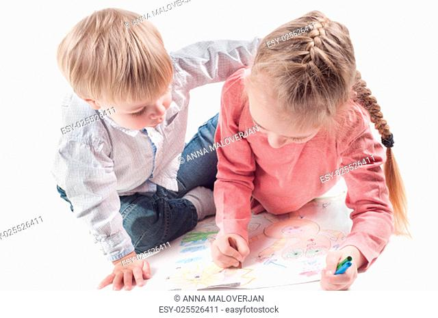 Shot of little girl and boy painting isolated on white