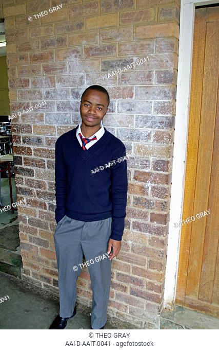 School boy outside classroom, St Mark's School, Mbabane, Hhohho, Kingdom of Swaziland
