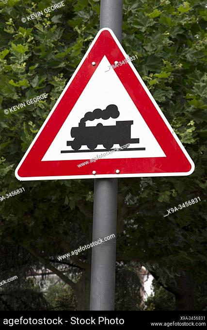 Red and White Railway Crossing Waring Sign