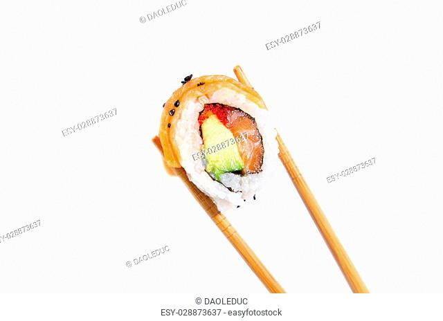 holding fresh maki sushi roll with wooden chopsticks, isolated on white background