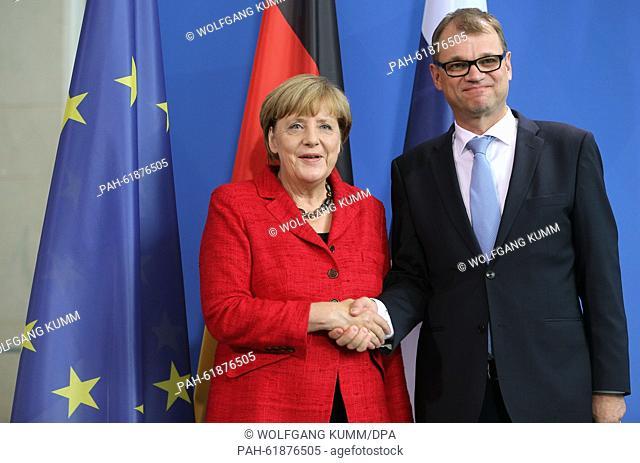 German Chancellor Angela Merkel (CDU) and prime minister of Finnland, Juha Sipila, shake hands after a press conference at the Bundeskanzleramt in Berlin