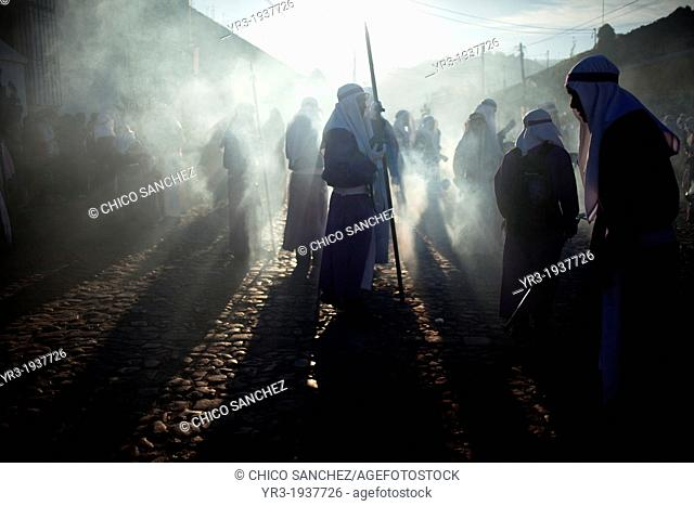 Penitents walk in a cloud of incense at the Jesus Nazareno de la Merced procession during Easter Holy Week procession in Antigua Guatemala, Guatemala, March 29