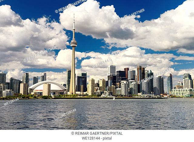 Downtown Toronto cityscape on Lake Ontario with clouds in the evening