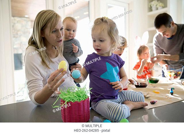 Mother and daughter with plastic Easter eggs