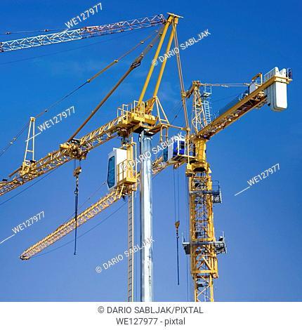 Construction crane isolated on clear blue sky