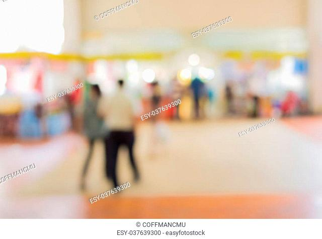 blurred image of people at trade show for background usage