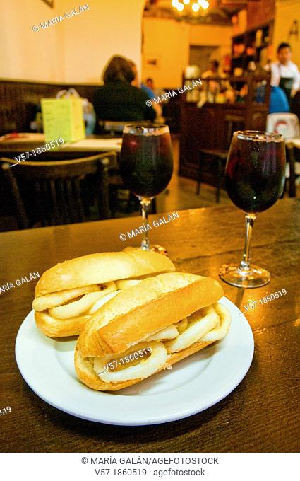 Fried squids sandwiches with sangria. Madrid, Spain