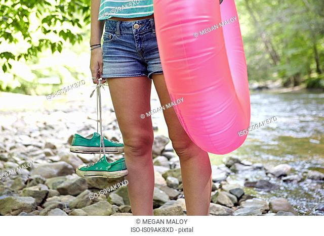 Hiker in forest with inflatable ring
