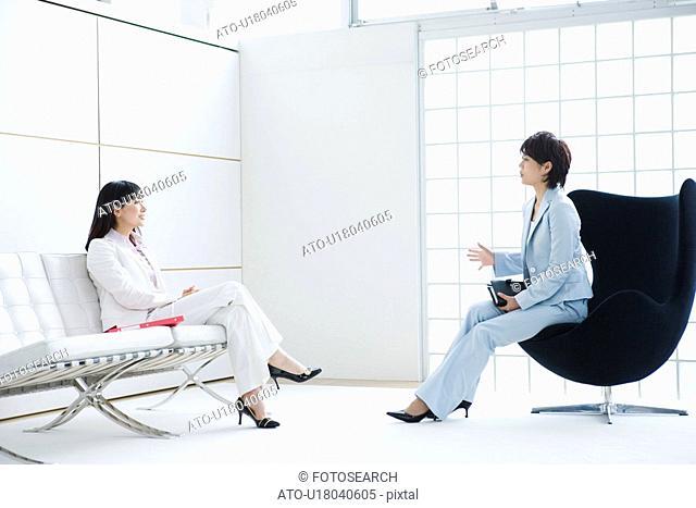 Business Scene, Young Women Talking in Office
