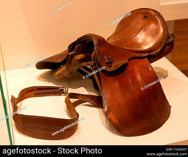 Old brown leather saddle, not in use anymore