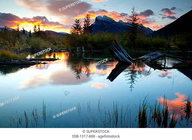 Reflection of mountains and clouds in a lake, Mt Rundle, Vermillion Lakes, Banff National Park, Alberta, Canada