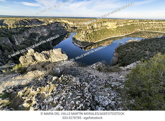 Duraton river gorge and ruins of St. Frutos hermitage on the background on a sunny day. Segovia. Spain. Europe
