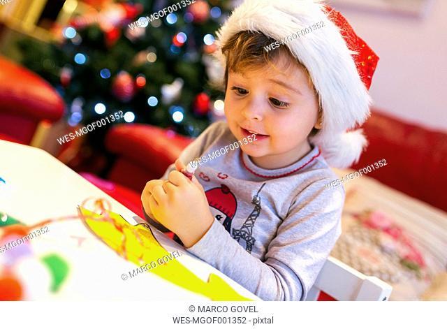 Portrait of little girl tinkering Christmas decoration