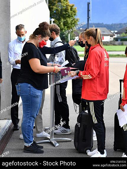 Belgian players and staff have their temperature checked before entering the stadium for a soccer game between Switzerland and Belgium's Red Flames