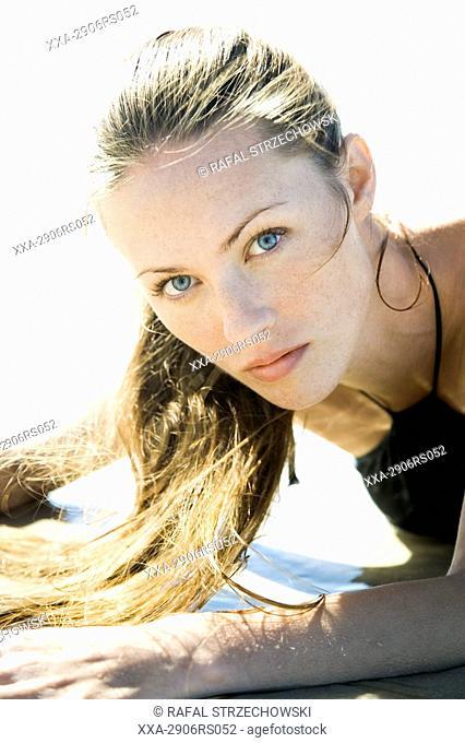beauty woman in black dress on beach