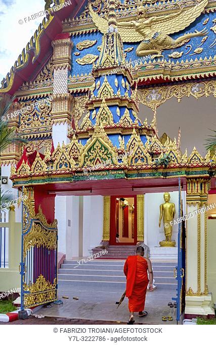 Monk entering Wat Mongkhon Nimit, Phuket Town, Thailand