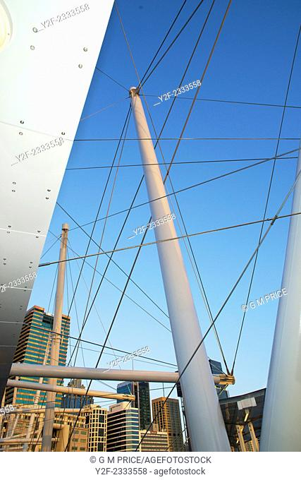 Brisbane city office buildings seen through wires and supports of Kurilpa Bridge, Australia