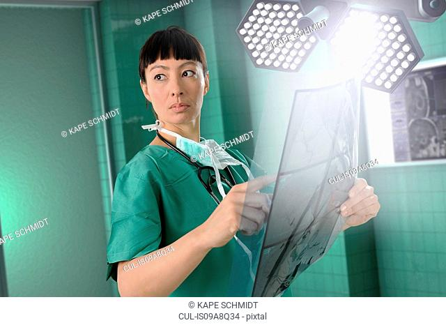 Female surgeon with scans