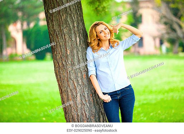 Beautiful Young Woman Relaxing Outdoors. Meadow. Beauty Girl Enjoying Nature