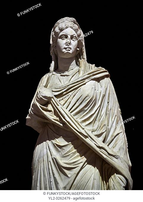 Roman statue of Sabina . Marble. Perge. 2nd century AD. Inv no 3066-3086. Antalya Archaeology Museum; Turkey. Against a black background