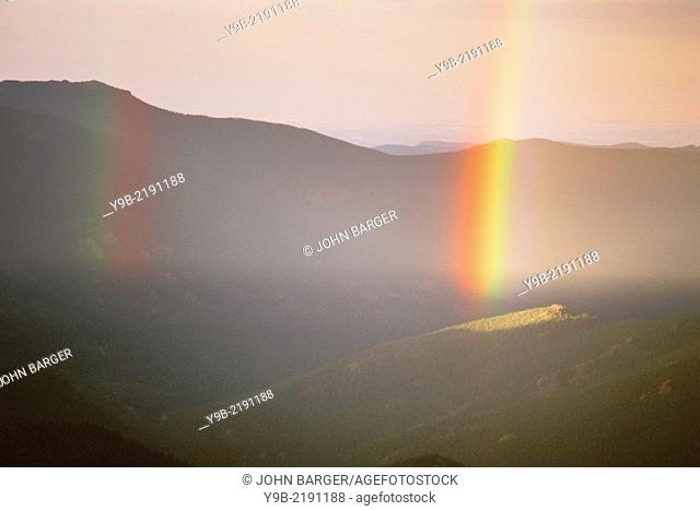 Rainbow over forest and mountains, Mt. Evans Recreation Area, Arapaho National Forest, Colorado, USA