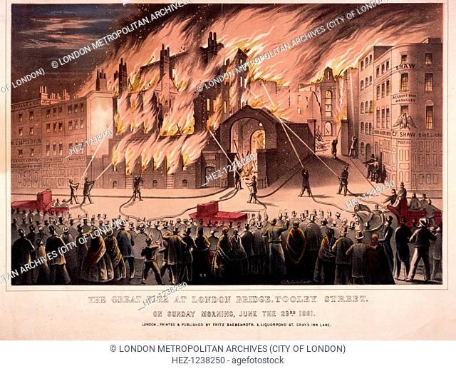 Firemen fighting the blaze at the Cotton's Wharf Fire, Bermondsey, London, 1861. The scene on the morning of Sunday, 23rd June 1861; firefighters train hoses on...