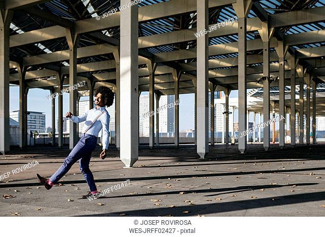 Spain, Barcelona, happy man dancing in the city