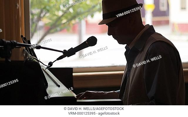 Musician plays piano in Providence, Rhode Island