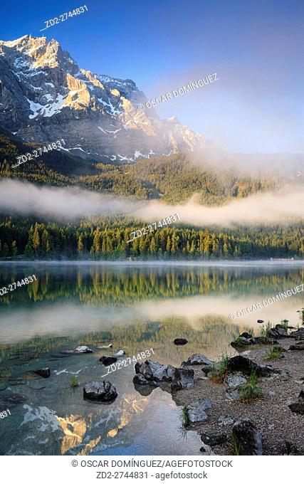 Zugspitze at sunrise with reflection in Eibsee. Garmisch-Partenkirchen. Upper Bavaria. Germany