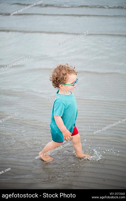 2 years old boy playing at the Beach in the Baltic Sea